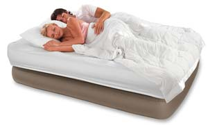 Couple happily sleeping on an airbed