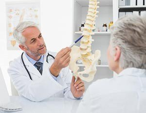 Doctor explaining chronic back pain to patient