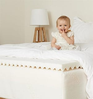 Superbe Cute Baby On A Mattress Topper