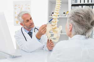 Doctor discussing back pain and mattresses with patient