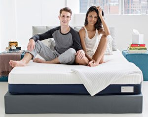 Happy couple after sex on the Helix Sleep mattress