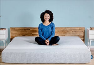 Girl sitting on the leesa mattress reviewed