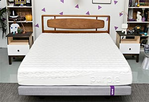The purple mattress reviewed in a bedroom