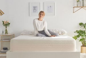 A lady sitting on the Brentwood Home Bamboo Gel 13 mattress reviewed