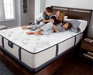mother and 2 children on a serta mattress
