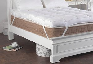 nice bed with a mattress topper