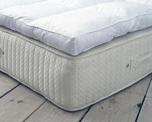 a wooden floor with mattress protector