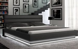 a california king size bed in a modern room