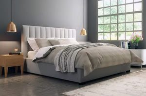 a queen size bed in a nice room