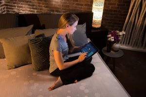 lady looking at the rest bed data on a tablet