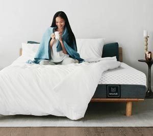 girl sipping coffee on the muse mattress