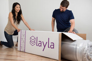happy people unboxing the mattress