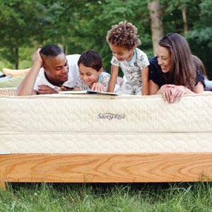 a happy family on the savvy rest mattress